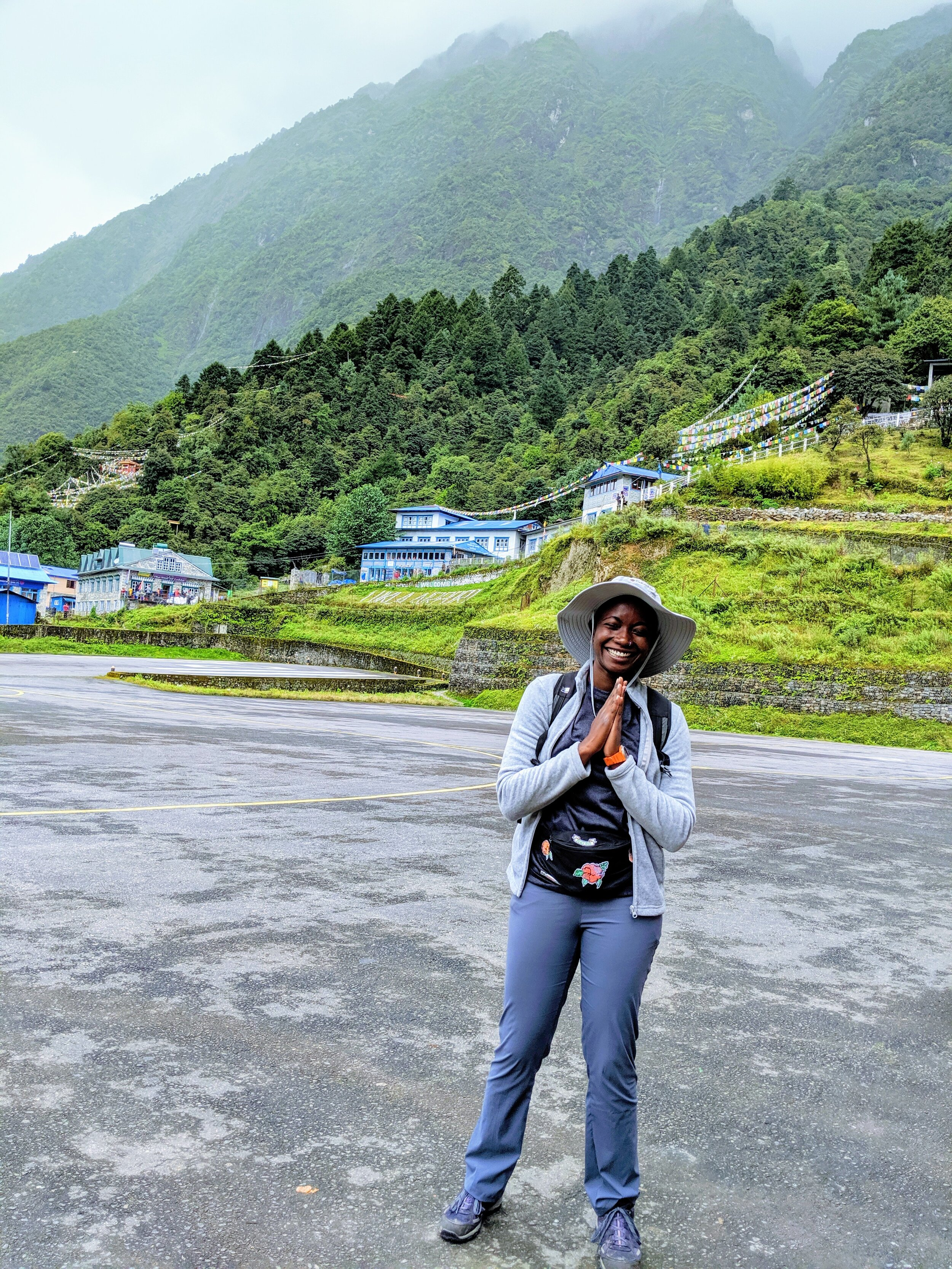 On the tarmac at Lukla Airport, elated at a safe journey