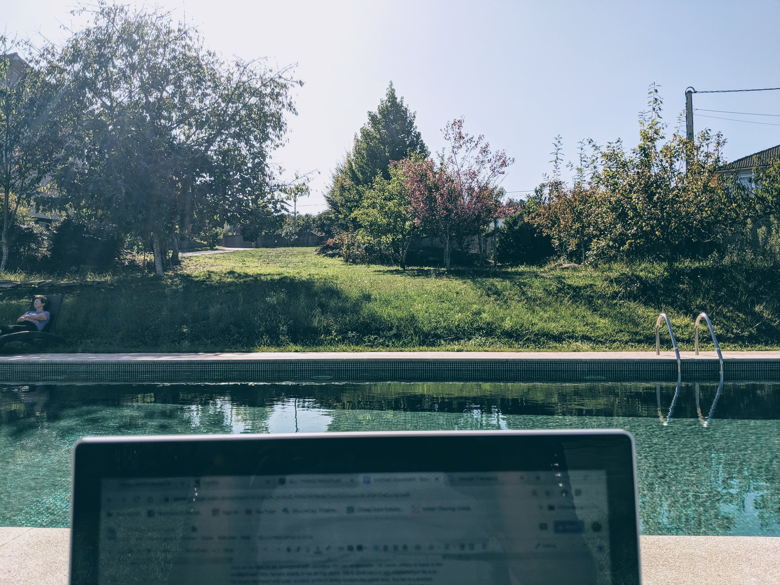 A sunny day spent relaxing by the pool, writing…